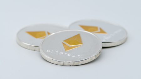 Physical metal silver Ethereum currency on white background. New worldwide virtual internet money. Digital Etherum coin cyberspace, cryptocurrency ETH. Good investment future of online payment