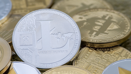 Physical metal silver Litecoin currency over others coins. New worldwide virtual internet money. Digital coin in cyberspace, cryptocurrency LTC. Good investment for the future of online payment