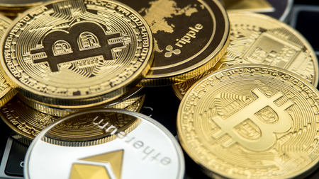 Physical metal currency on notebook computer keyboard. New worldwide virtual internet money. Digital coins cyberspace, cryptocurrency. Good investment future online payment Stock Photo