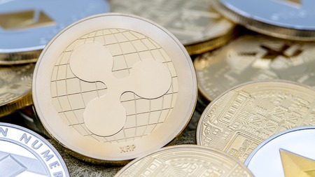 Physical metal golden Ripplecoin currency over others coins. Worldwide virtual internet money. Digital Ripple coin in cyberspace, cryptocurrency gold XRP. Good investment future online payment