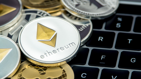 Physical metal silver Ethereum currency, notebook computer keyboard. Worldwide virtual internet money. Digital Etherum coin cyberspace, cryptocurrency ETH. Good investment future online payment