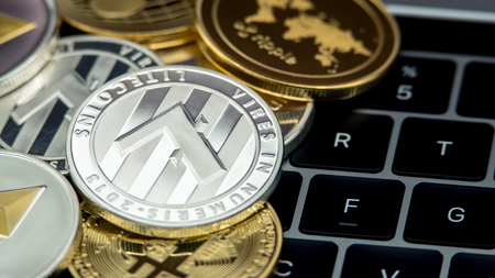 Physical metal silver Litecoin currency on notebook computer keyboard. New worldwide virtual internet money. Digital coin cyberspace, cryptocurrency LTC. Good investment future online payment Stock Photo