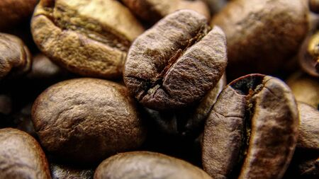 Close up of many roasted coffee beans