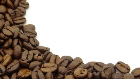 Close up of roasted coffee beans on white background