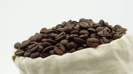 A sack with roasted coffee beans on white background Reklamní fotografie