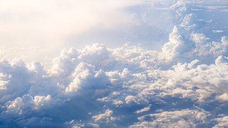 Wonderful view of the sky and clouds with the light the sun from above, as seen through airplane window. Beautiful view of passenger traveling by air. Travel in cabin at plane Reklamní fotografie - 125072474