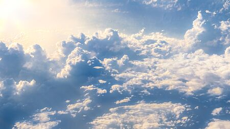 Wonderful view of the sky and clouds with the light the sun from above, as seen through airplane window. Beautiful view of passenger traveling by air. Travel in cabin at plane Reklamní fotografie - 125072475
