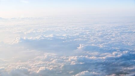Wonderful view of the sky and clouds with the light the sun from above, as seen through airplane window. Beautiful view of passenger traveling by air. Travel in cabin at plane Reklamní fotografie - 125072477