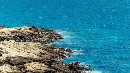 Coast with waves in the tropical Taiwan Island. Sea surfs are splashing on the rocks. The wave ocean on the shore