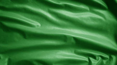 Green textile cloth flag, background abstract with soft waves. Concept signs symbols indicate safety in the water at the beach. Realistic fabric texture with softness mood wavy Imagens