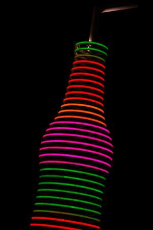 soda pops: Neon Pop bottle Stock Photo