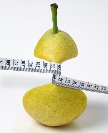 Pear jammed by measuring tape - surrealist montage.
