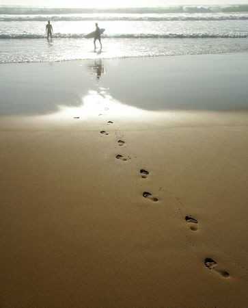 Foot prints going to the ocean.