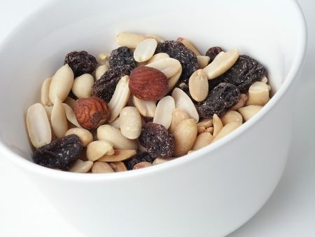 Raisins and nuts in white Bowl