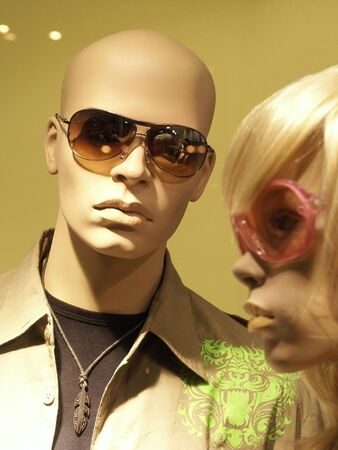 skinhead: Mannequins in store with clothes.