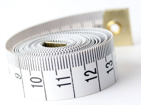 metric: Tape measure used for making clothing alterations and to measure body parts. Stock Photo