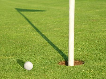 Ball near the target on the Golf-Field Stock Photo - 462331