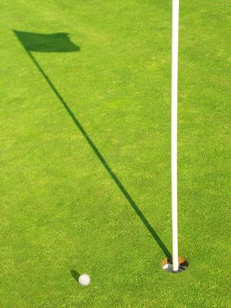 Ball near the target on the Golf-Field Stock Photo