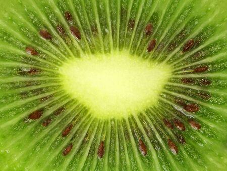 freshest: Kiwi fruit with macro lens. Center. Stock Photo