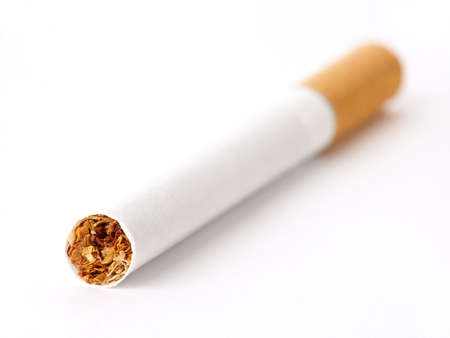 pernicious: Cigarette on white. Soft Focus.