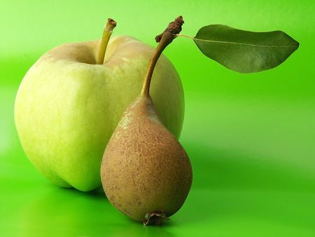 Apple & Pear with Fluorescent Green Background. Stock Photo - 535840