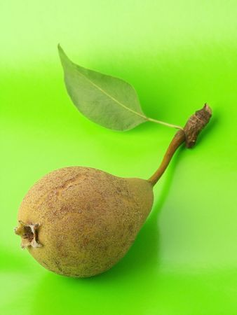 Pear with Fluorescent Green Background. Stock Photo - 535841