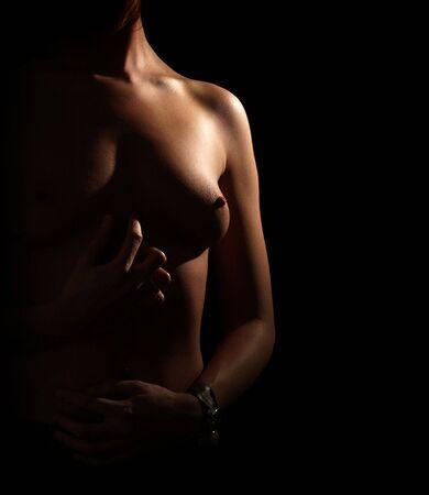 Brust. Sidelight. Black bacground.