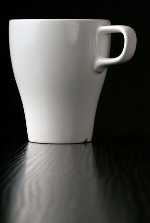 An white Cup on black. photo