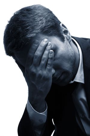 Sad Man with his Hand on his Head. White background. Blue.