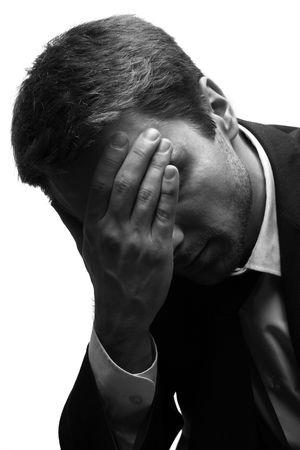 Sad Man met zijn hand op zijn hoofd. Witte achtergrond. Blauw. Stockfoto