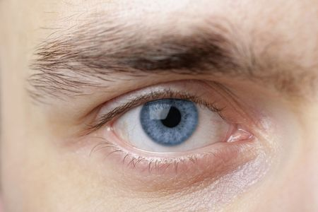 green eye: Extreme close-up of mens blue eye. Stock Photo