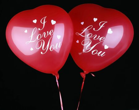 Valentine Heart Balloons on black background. With inscription photo