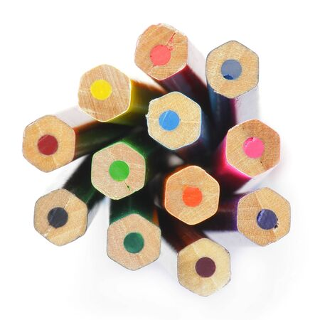 Colored wooden Crayons. Isolated on white background. Downside view. Soft focus. photo