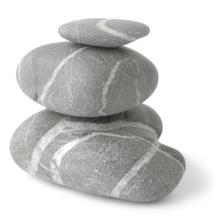 Pyramid of three stones over white. Soft focus. Stock Photo