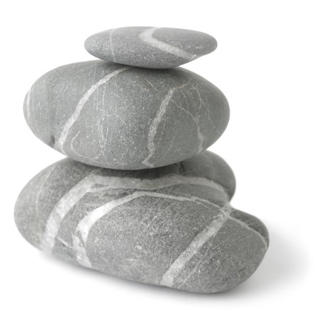 Pyramid of three stones over white. Soft focus. Stock Photo