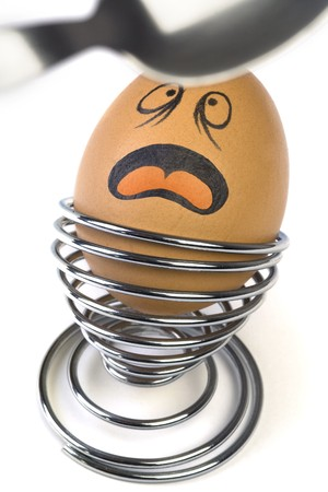 Funny comical Egg scared with coming Spoon. Stock Photo - 4489150