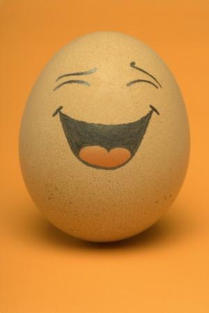 Single, Smiling comical Egg with orange background.