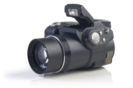 telezoom: Digital compact camera against a white background with reflection.