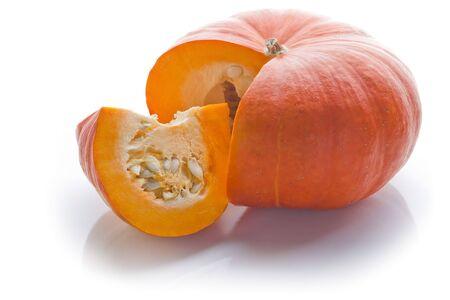 Schneiden Sie orange Pumpkin, isolated on white Background. Back lit. Lizenzfreie Bilder