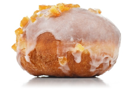 Horizontal view of an sugar glazed donut with candied orange peel. Isolated on white. Stock Photo
