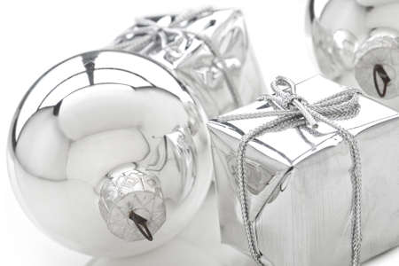 silver reflection: Present boxes and silver bulb on white.