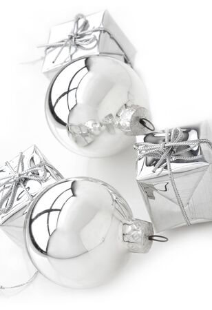 Present boxes and silver bulb on white. photo