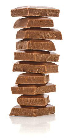 Stack of milk chocolate isolated on white background  photo
