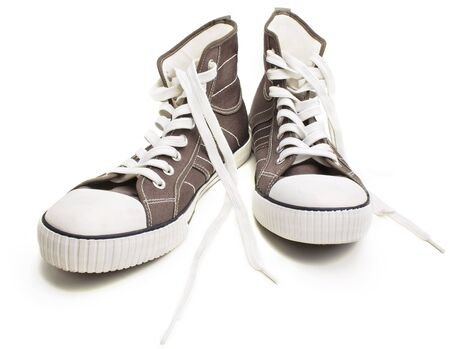Two sneakers isolated on a white background  Closeup view  Stock Photo