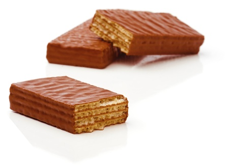 Broken chocolate waffles on a white background Soft focus