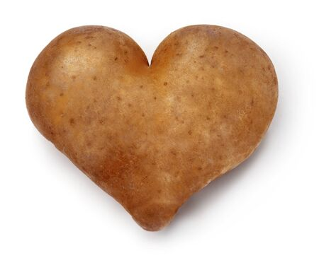russet: Heart shaped Potato on a white background  Saturated colors