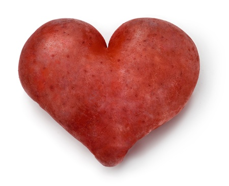 Heart shaped red Potato on a white background