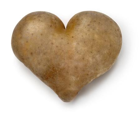 Heart shaped Potato on a white background. Zdjęcie Seryjne