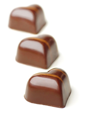 endorphines: Heart shaped Chocolate Pralines on a white background. Soft Focus.