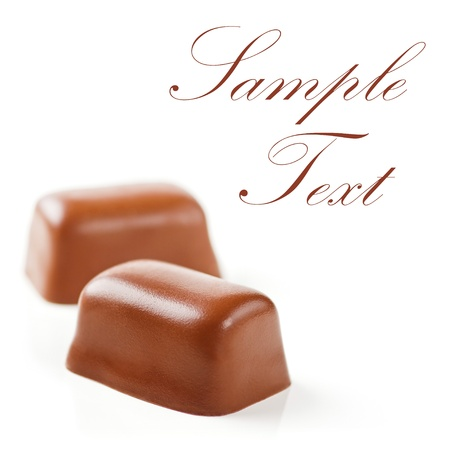 toffee: Chocolate Sweets isolated on a white background. Soft Focus. Sample Text.  Stock Photo